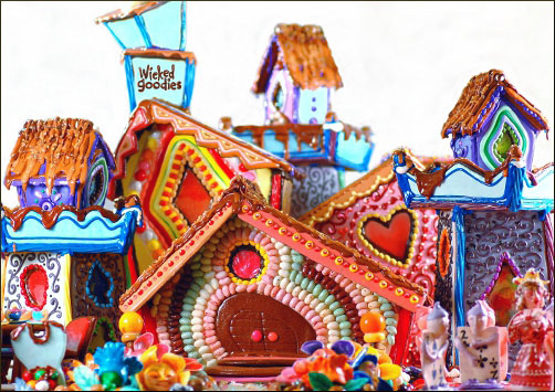 This giant gingerbread house interpretation of Alice in Wonderland is 4′ x 4′ x 2 1/2′ (1.2 x 1.2 x .76 m) and is made of gingerbread cookies, royal icing, gumpaste, and candy. It won second place at the 2009 Gingerbread City Competition in Del Mar, California and is still on display at the Chula Vista library.
