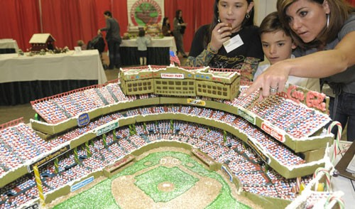 "A trio of people from a Boston Legal Seafoods won ""Best in Show"" and ""Kids Choice"" in the 2008 Boston Gingerbread House Competition with their edible version of Red Sox home stadium Fenway Park."